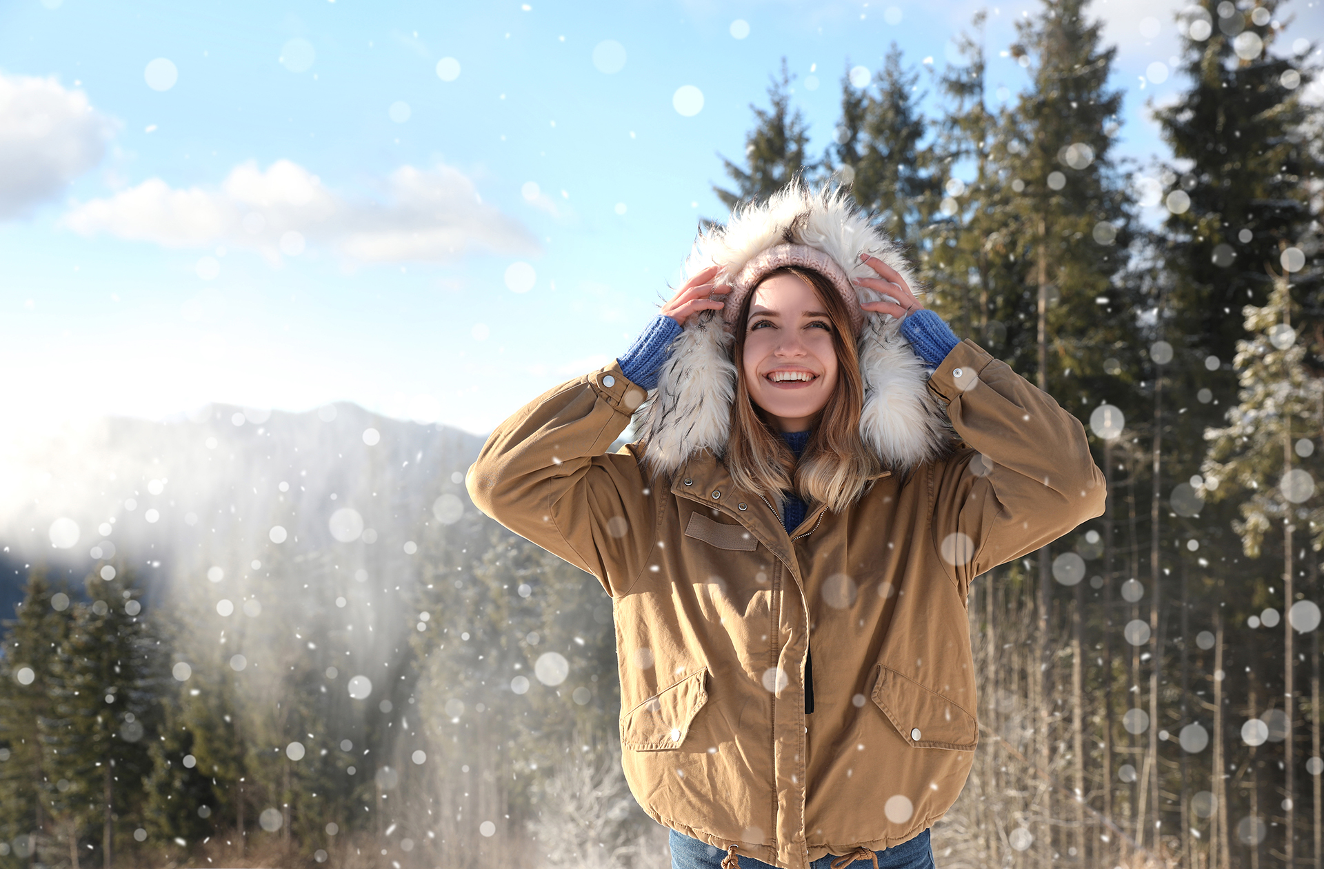 Happy young woman spending winter vacation in mountains. Space f