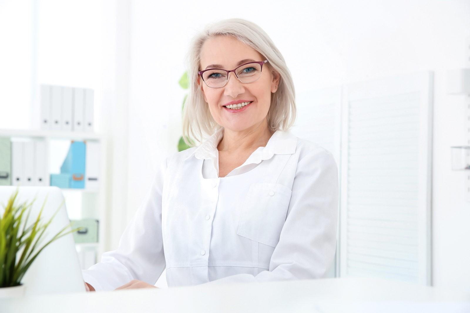 Senior female receptionist working in hospital