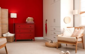 Modern room interior with red chest of drawers