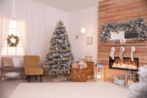Festive interior with beautiful Christmas tree and gifts